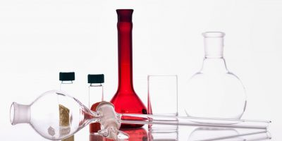 Chemistry glassware with test tubes and beaker.