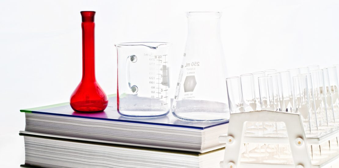 Chemistry book and glassware